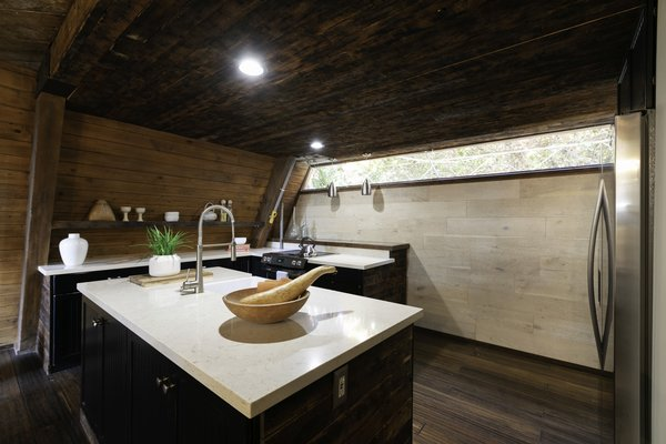 The indoor/outdoor kitchen has been renovated and is equipped with top-of-the-line appliances. The clear highlight, however, is its retractable back wall.