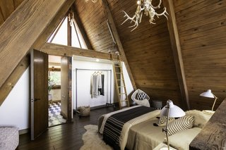 The room has an ensuite bathroom and an attic space that could serve as a reading nook, meditation space, or storage.