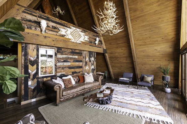 A second, lofted bedroom is perched above the living room.