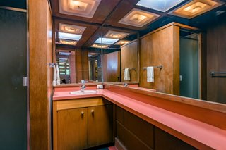 In the bathroom, even the shower is paneled in Philippine mahogany.
