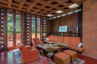 As with most Usonian homes, the living room features high ceilings. The living room also opens to an outdoor terrace.