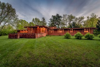 The Usonian Automatic home is built of pre-cast, terra-cotta tinted concrete blocks, formed on a two-foot module.