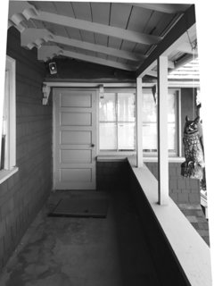 An enclosed porch was situated just off the master bedroom.