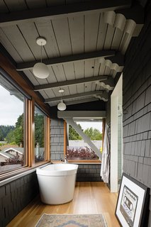The porch now serves as a master bath with a deep soaking tub.