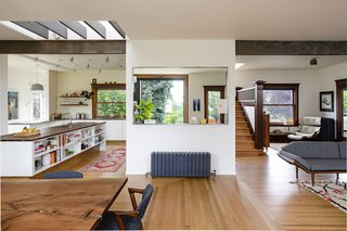 This view shows how the spaces in the great room connect to each other. The architects cut a light well through the center of the home to bring daylight all the way down to the kitchen.