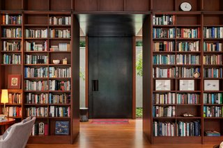 The custom bookshelves are made of mahogany sourced from the Seattle Symphony Orchestra's Benaroya Hall.