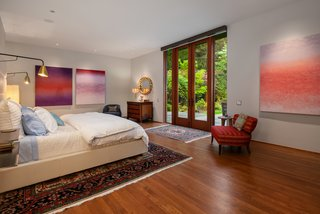 The master bedroom features spacious walk-in closets with mahogany dressers, a skylight, and French doors leading to the backyard.