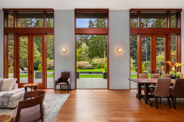 Full-height French doors topped with clerestory windows flood the open space with natural light.