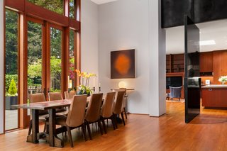 An oversized steel pivot door can close off the dining room.