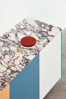 The option to add a Calacatta Viola marble countertop makes a particularly bold statement.