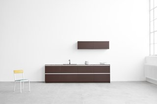"""A selection of dark wood fronts highlights David Thulstrup's focus on material and his classic sense of style, which the designer describes as """"modern simplicity."""""""