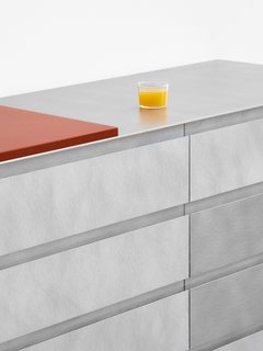 This hand-brushed aluminum front, paired with a metal countertop, feels surprisingly warm and textured.
