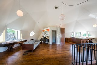 The lofty dome has a great room with a kitchen, dining, and living space.