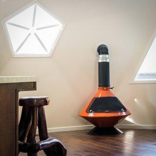 A bright orange stove keeps the interior toasty.