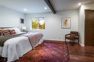 Exposed beams throughout the house echo the hardwood floors.