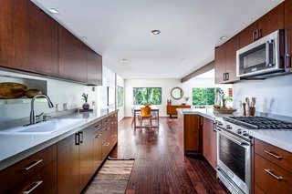 Warm wood cabinetry lines the kitchen.