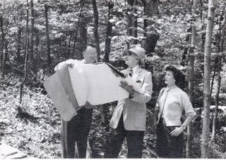 Betty Corwin and Richard Neutra survey the plans.