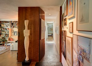 A hallway leads to the family's private space.