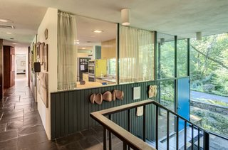 The kitchen is enclosed by windows, which gives the home a strong indoor/outdoor connection.