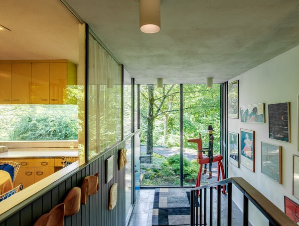 Walls of glass, a signature Neutra element, are found throughout the home.