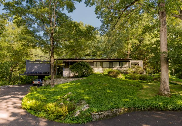 Set on 4.3 acres of riverfront property perched dramatically above the Saugatuck River in Weston, Connecticut, the five-bedroom, three-bath Corwin House is well preserved—with only a few updates to the kitchen and baths.