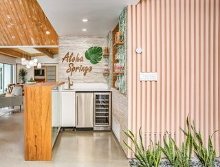 It also features a fun, tropical-themed wet bar.