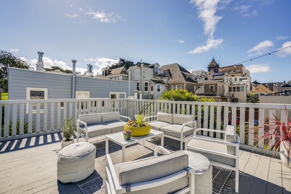 The home also has a private rooftop deck with city views.
