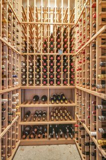 The garage features a custom redwood wine cellar.