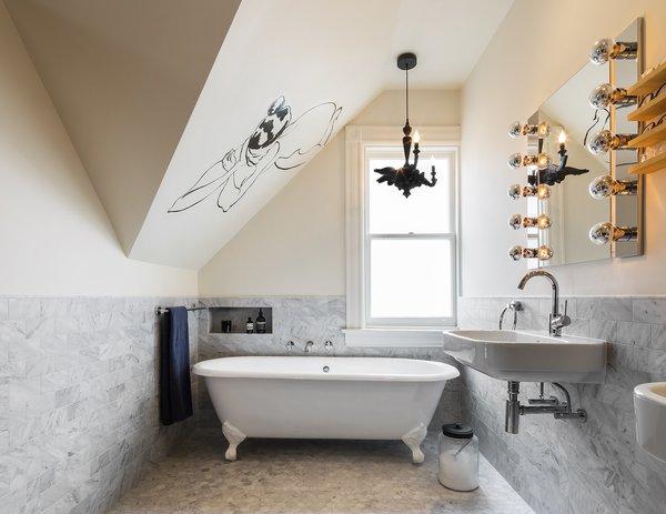 The master bathroom has a freestanding tub by Randolph Morris. Local artist Tatiana Hockenos painted above the tub in the master bathroom. The shower is separate.