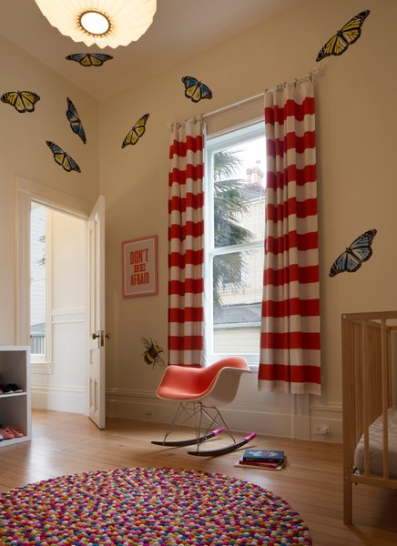 Butterflies and insects by Fnnch decorate the walls of one of the children's rooms.