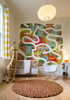 A large mural by Brian Barneclo is located in the nursery.