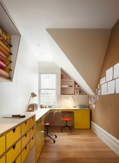 The home office features a laminate desk and cabinets in a bright, cheery yellow. They were designed by Bohlin Cywinski Jackson and made by Tomlinson Woodworks.