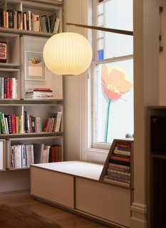 The custom-made reading nook. A Fnnch poppy mural is located on the outside wall.