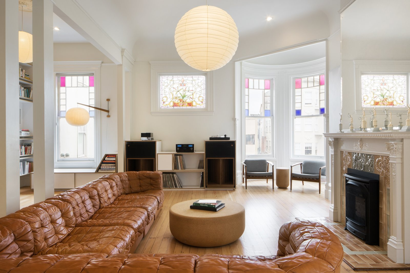 The 1894 Queen Anne Victorian features an open floor plan that juxtaposes classic original features with cool modern elements—many of which are customized for the home.
