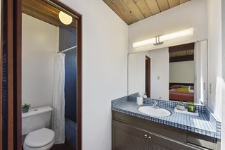 The master bath features blue tile.