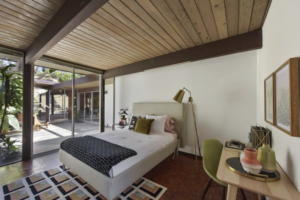 This bedroom would also make a good home office. It is directly connected to the central atrium and therefore offers less privacy.