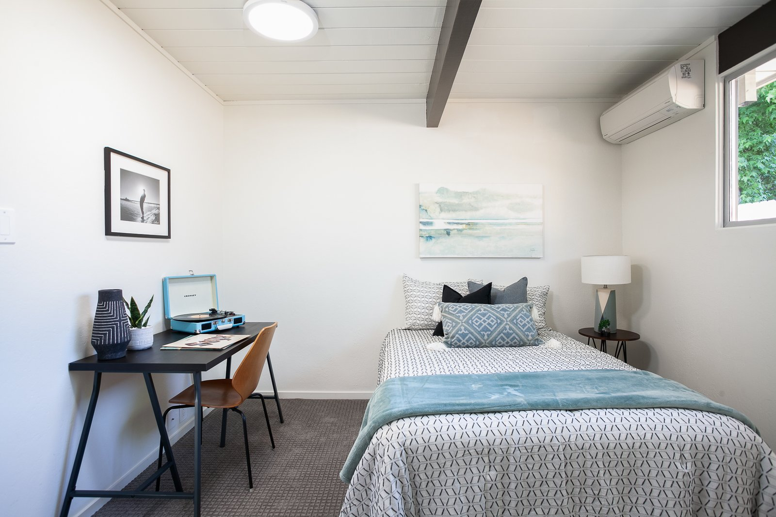 Bedroom, Table, Bed, Night Stands, Ceiling, and Carpet There are four bedrooms in total. All of which are standard Eichler bedroom size.  Bedroom Carpet Ceiling Photos from A Spacious and Stylish Orange County Eichler With a Pool Seeks $1.25M