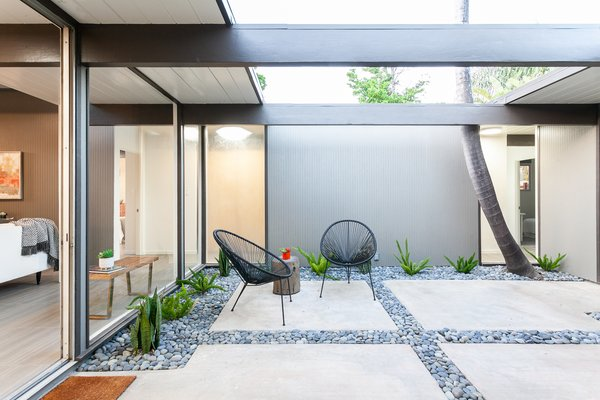 The home opens to a spacious central atrium. It's a serene space that celebrates indoor-outdoor living.