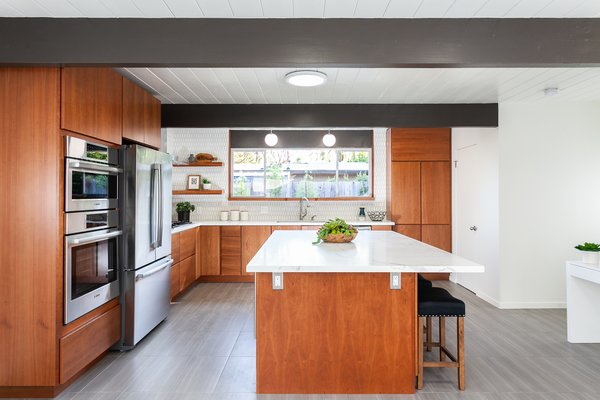 The renovated kitchen perfectly integrates into the home's midcentury vibe.