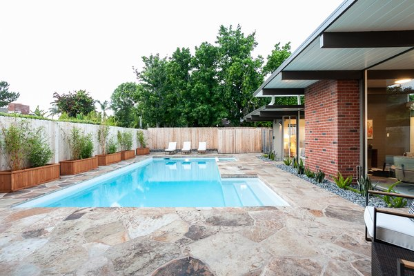 The backyard has been given over to a pool which is perfect for indoor-outdoor entertaining.
