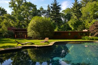The serene backyard even boasts an in-ground swimming pool.