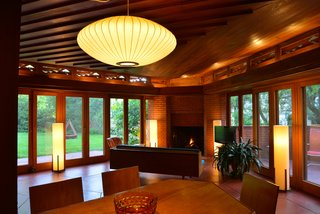 Like in most of Wright's Usonian designs, there are floor-to-ceiling windows to allow for natural light. The living room features 14 French doors which open to a patio for indoor/outdoor living. Even the fireplace is triangular.