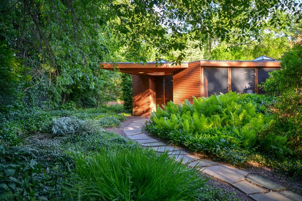 The home was previously occupied by the president of the Frank Lloyd Wright Building Conservancy (FLWBC), and has been lovingly restored over the years. A dramatic, cantilevered entryway sets the tone for visitors.