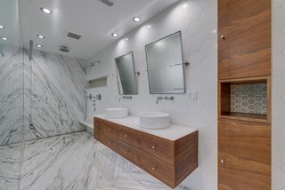 The luxurious master bath features heated marble slab floors.