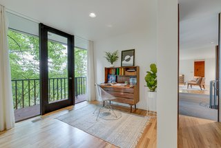 This bedroom (currently configured as a home office) has direct access to the terrace.