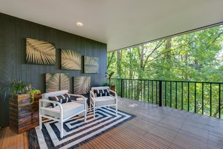 A small covered lanai-like patio provides a place to enjoy the outdoors, even if it's raining.