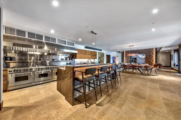 The spacious, open kitchen is decked out with four Wolf ranges and two refrigerators.