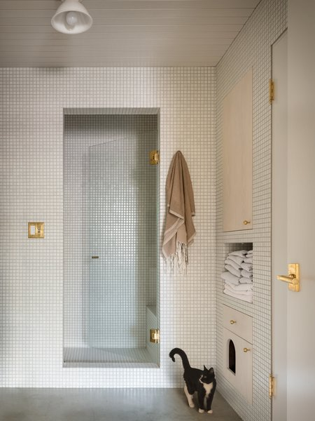"""""""[The tiling] was all very intentional and painstakingly difficult to execute and the tiler, Jennifer Ferrante, is truly a tile goddess,"""" says Eng-Goetz. """"She individually mitered all of the tiles that make up every single outside corner that you see in the bathroom and the kitchen."""""""