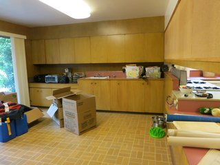 """With """"pepto-colored countertops and stained linoleum flooring"""" the original kitchen was dark and in desperate need of updates."""