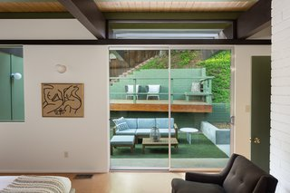 The glass provides lots of natural light and serene views of the surrounding greenery.